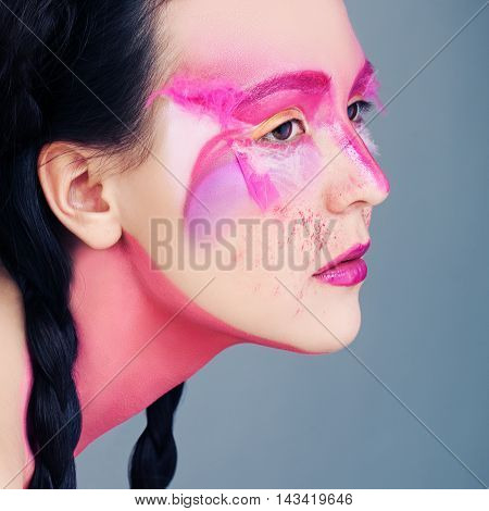 Ethnic Style Portrait. Woman with Art Makeup and Black Braids