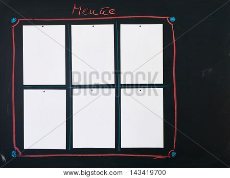 Black chalkboard as Menue Board with six empty white sheets of paper attached to it.