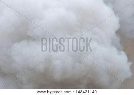 thick white smoke on black background .