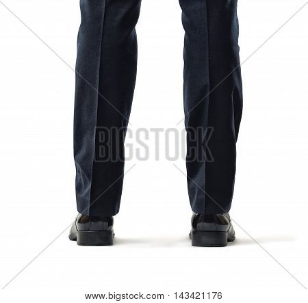 Back view of cropped legs of a businessman isolated on white background. Business staff. Office clothes. Big feet. Domination and superiprity.