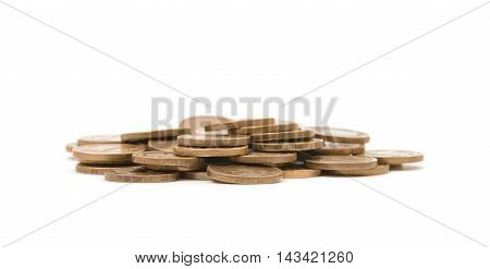 Heap of golden coins isolated on white background. Money and wealth. Prosperity and success. Economy and finance.