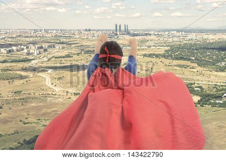 Woman Superhero With Red Cape Is Flying On Top Of City. Vintage Color
