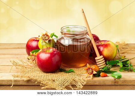 Honey jar with apples and pomegranate for Jewish New Year Holiday