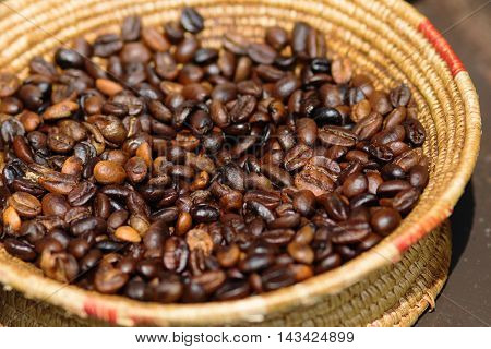 brown coffee beans in a wattled bowl