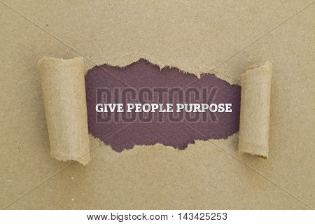 GIVE PEOPLE PURPOSE message written under torn paper.
