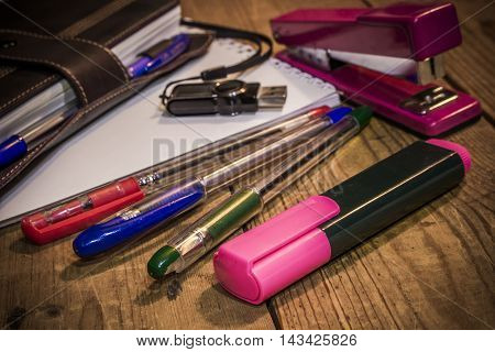 Stationeries items on the old wooden table