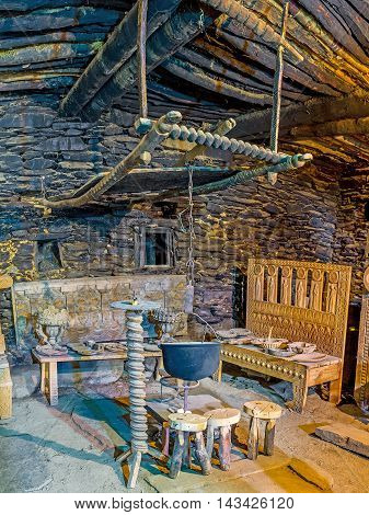 USHGULI GEORGIA - MAY 22 2016: The old cauldron for cooking over an open fire in Ethnographic Museum in the medieval house of Svan family on May 22 in Ushguli.