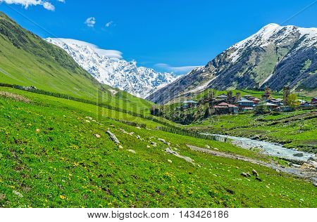 The picturesque Ushguli comunity located in Enguri gorge and the snowbound Shkhara Mount on the background Svaneti Georgia.