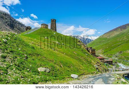 The stone Svan tower on the hill overlooks all the Ushguli comunity and mountain range around it Svaneti Georgia.