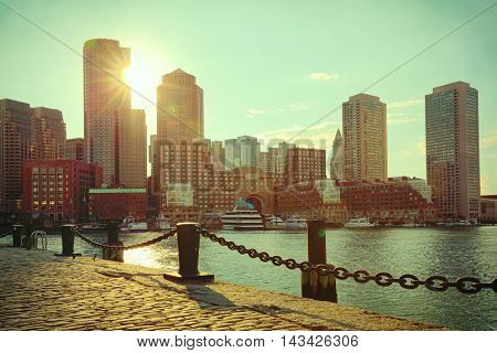 Boston Harbor and Financial District at sunset. Boston- Massachusetts USA. Retro filter effect.