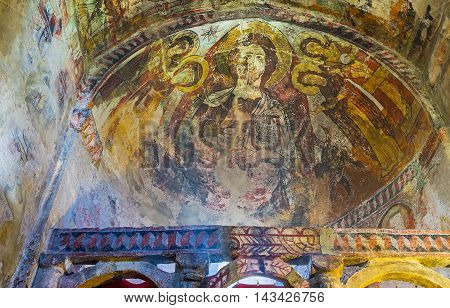 USHGULI GEORGIA - MAY 22 2016: The apse of Lamaria Church is covered with old fresco depicting Jesus Christ and the Saints on May 22 in Ushguli.