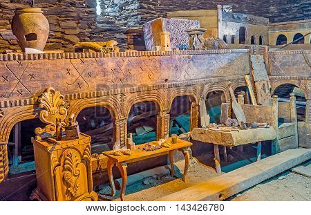 USHGULI GEORGIA - MAY 22 2016: The carved wooden furniture in Ethnographic Museum in the medieval house of Svan family on May 22 in Ushguli.
