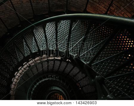 dark metal staircase in Currituck Beach Lighthouse and Museum