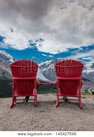 Reverse View of Red Chairs Looking Out Over Canadian Rockies