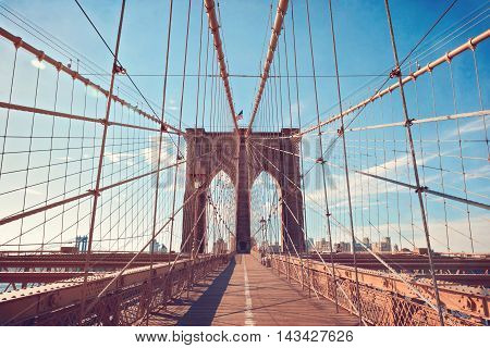 Brooklyn Bridge in New York City over blue cloudy sky