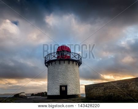 Lighthouse situated just outside the harbour at Burry Port, Carmarthenshire, Wales.