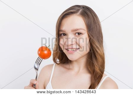 Smiling Girl With Tomato