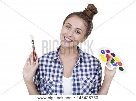 Close up of woman in checkered shirt holding paintbrush and palette. Concept of creativity and inspiration. Mock up