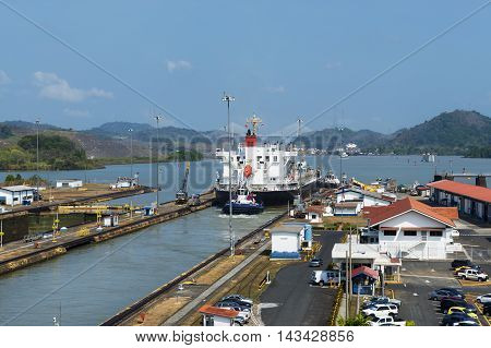 Panama Canal Panama - March 17 2014: A cargo ship in the Miraflores Locks in the Panama Canal in Panama