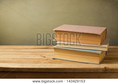 Vintage books in pastel color on wooden table with copy space
