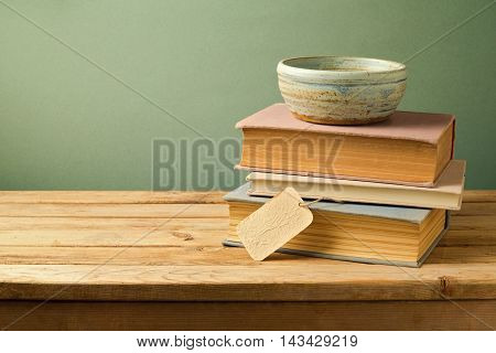 Vintage books and bowl on wooden table