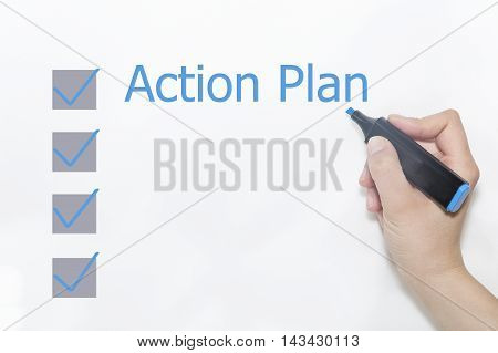 A hand with a marker writing 'Action Plan'.