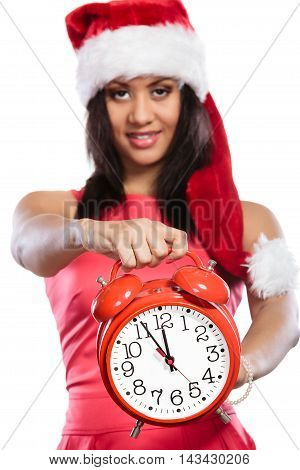 Mixed Race Woman In Santa Hat With Alarm Clock.