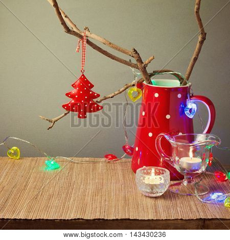 Christmas table decorations with tree branch in a jar