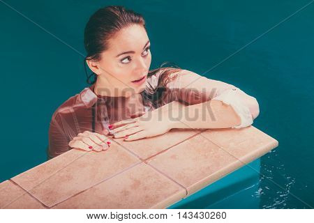 Portrait Of Sexy Seductive Woman At Poolside Water