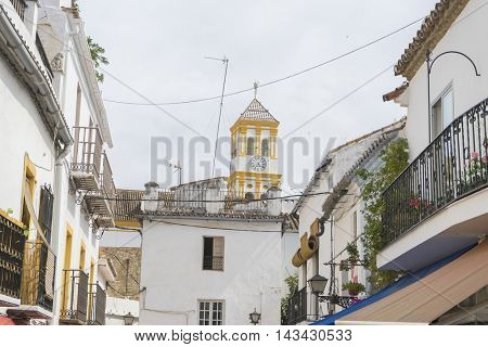 destination, architecture and streets of white flowers in Marbella Andalucia Spain