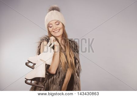 Smiling Lady With Pair Of Skates.