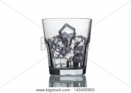 Glass For Whiskey With Ice Cubes Isolated On White Background