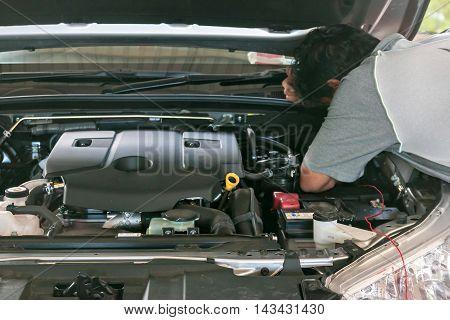 Technicians are repairing car at auto Repair Center.