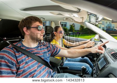 Couple travelling by car in the mountains