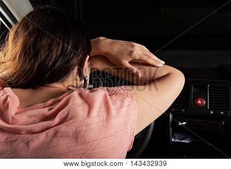 Woman Driver Sleep On Car Wheel