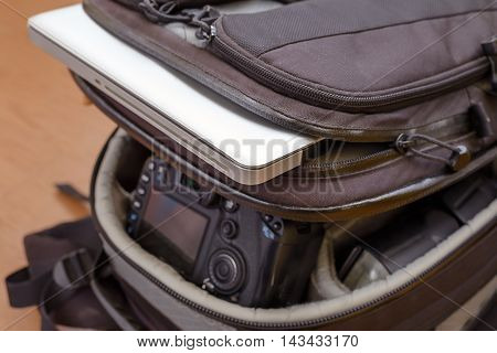 Professional Photography Equipment and Laptop in Protective Backpack