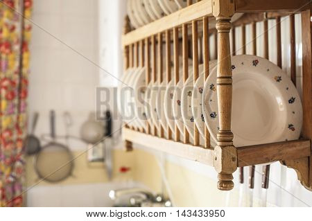 Old wooden plate rack in a cottage kitchen Spain