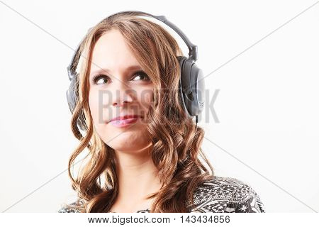People leisure relax concept. Young woman in big headphones listening music mp3 relaxing on white