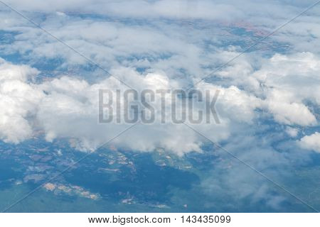 Clouds in the skyView from window plane .