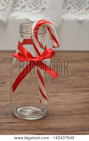Twp Candy canes displayed in a bottle
