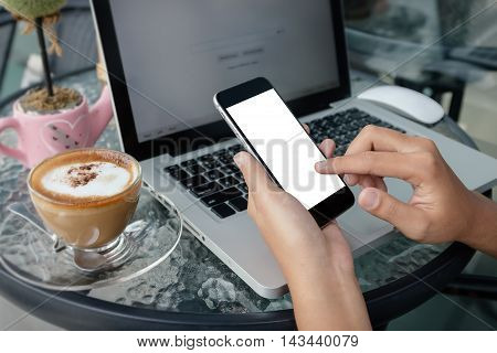 close up hand use phone in coffee shop