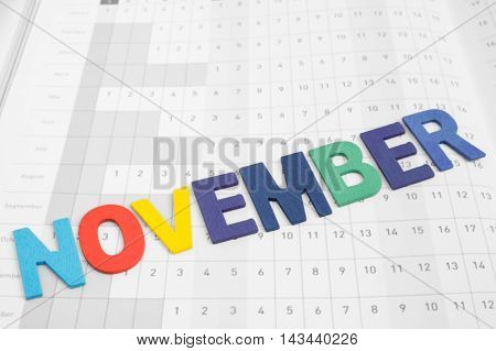 November - monthly on date number calendar paper - colorful uppercase letter November month