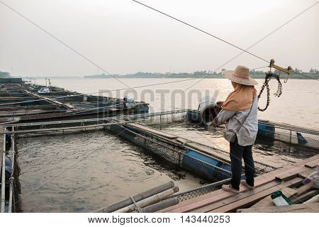 Fishermen scoops fish of Thailand river .