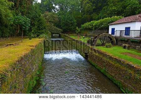 Watermill and gardens in Furnas Azores. The old watermill at night on Sao Miguel Island Portugal.