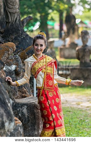 Women have a Thai dress in temple Thailand.