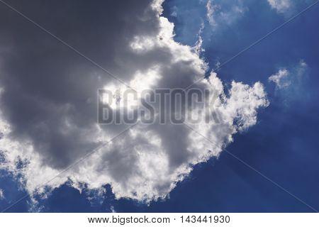 A cumulus cloud floats through the sky above Joliet, Illinois.