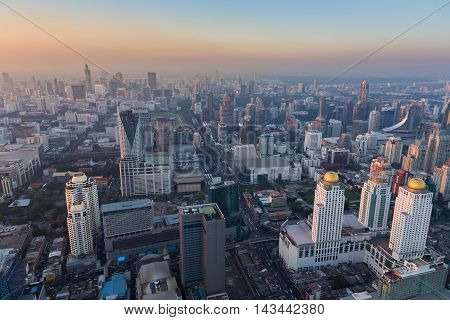Top view Bangkok city downtown with sunset sky background, Thailand