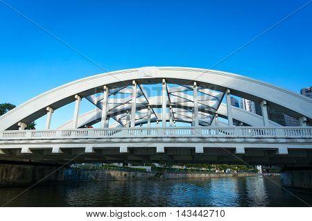 Bridge across Singapore river. Close up of Elgin bridge. Singapore financial district