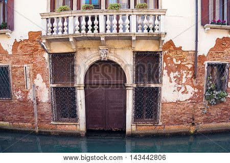 Ramshackle Door Of Typical Venice Residential House. Italy