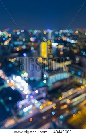 Abstract background, blurred lights city downtown at twilight